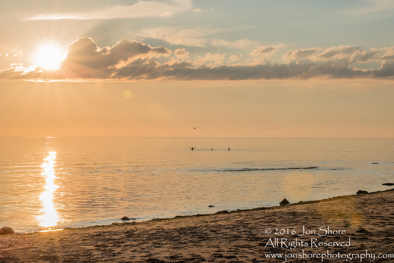 Sunset Tuja, Latvia with boys in the sea. Tamron 200m