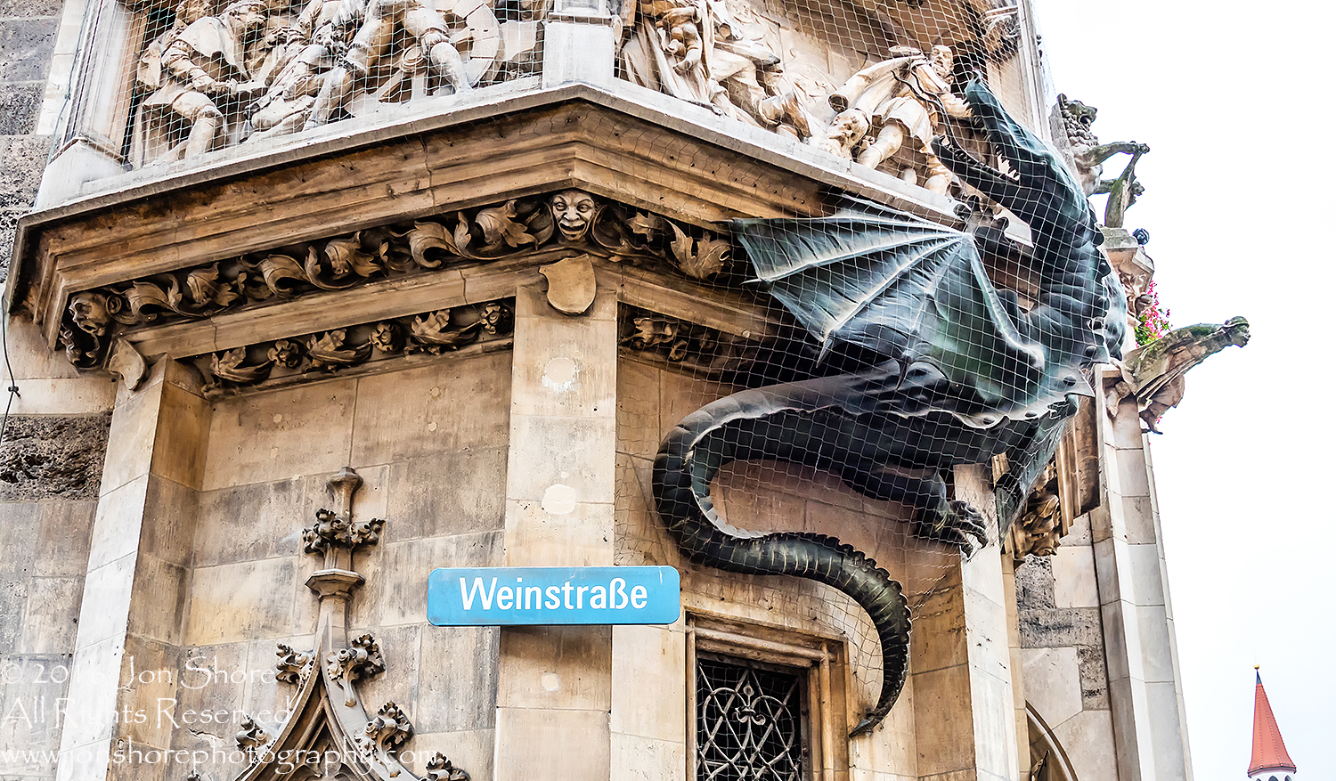 Netted Dragon on Munich City Hall. Nikkor 300mm