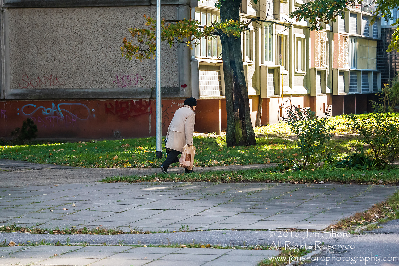 Old woman walking with bag. Zolitude, Latvia. Nikkor 200mm