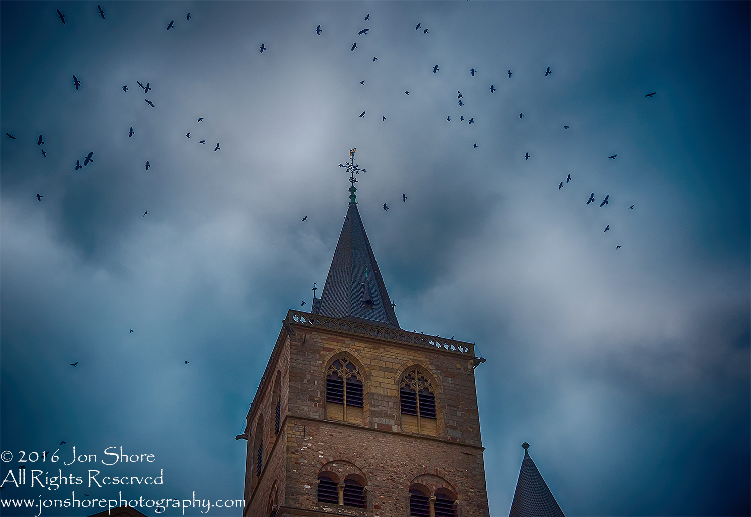 Crows atop Cathedral, Trier, Germany. Nikkor 300mm
