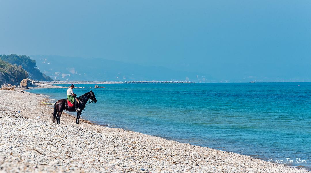 Horse and man on beach Vasto Italy